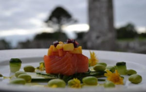 Cured salmon on plate with cucumber and broad beans