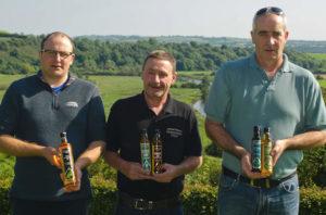 Jack and the lads holding Newgrange Gold bottles