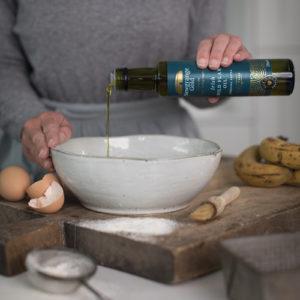 Lady cooking using Newgrange Gold Wild Flax Oil