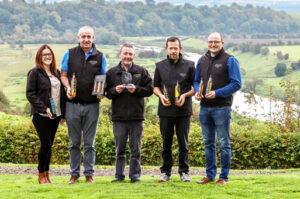 Newgrange Gold Team holding bottles of Newgrange Gold Rapeseed Oil